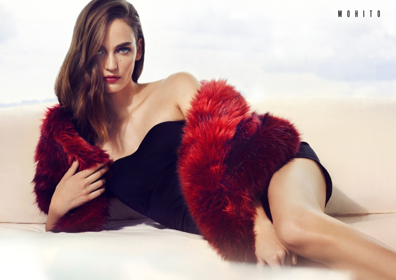 The model gets seductive in red fur