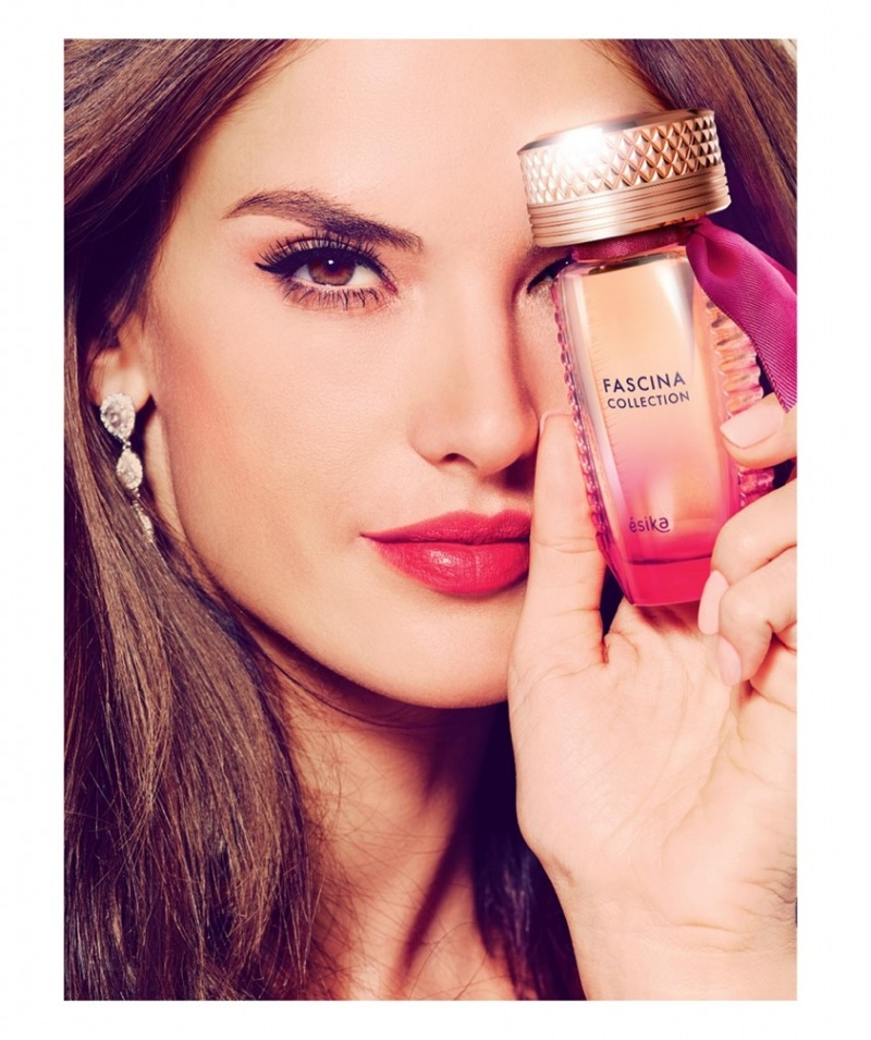 Alessandra wears a vibrant red lipstick shade in this image
