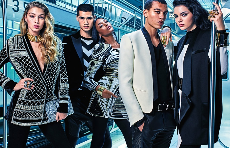 Models wear sharp tailoring from the Balmain x H&M collaboration