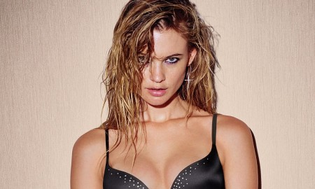 The model shines in a rhinestone embellished black bra