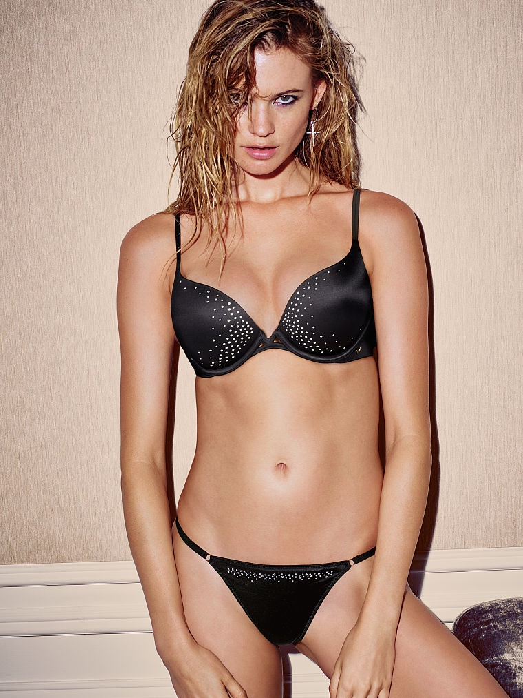 The model shines in a rhinestone embellished black bra