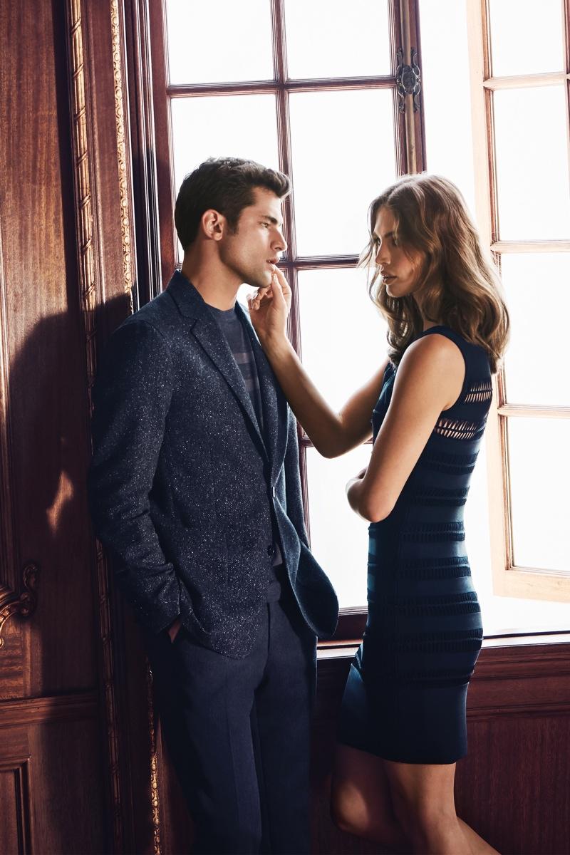 Sean wears a sharp suit while Crista models an elegant little black dress from Cerruti