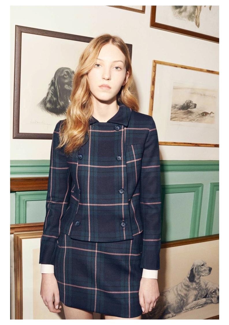 Ella models a matching plaid print jacket and skirt look