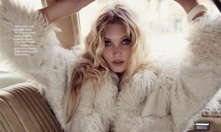 Elsa models a faux fur coat from Stella McCartney