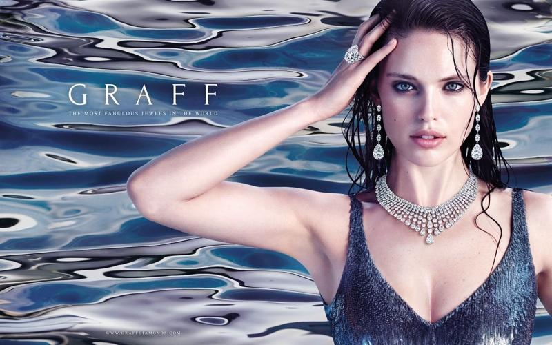 The model sparkles in diamond jewelry