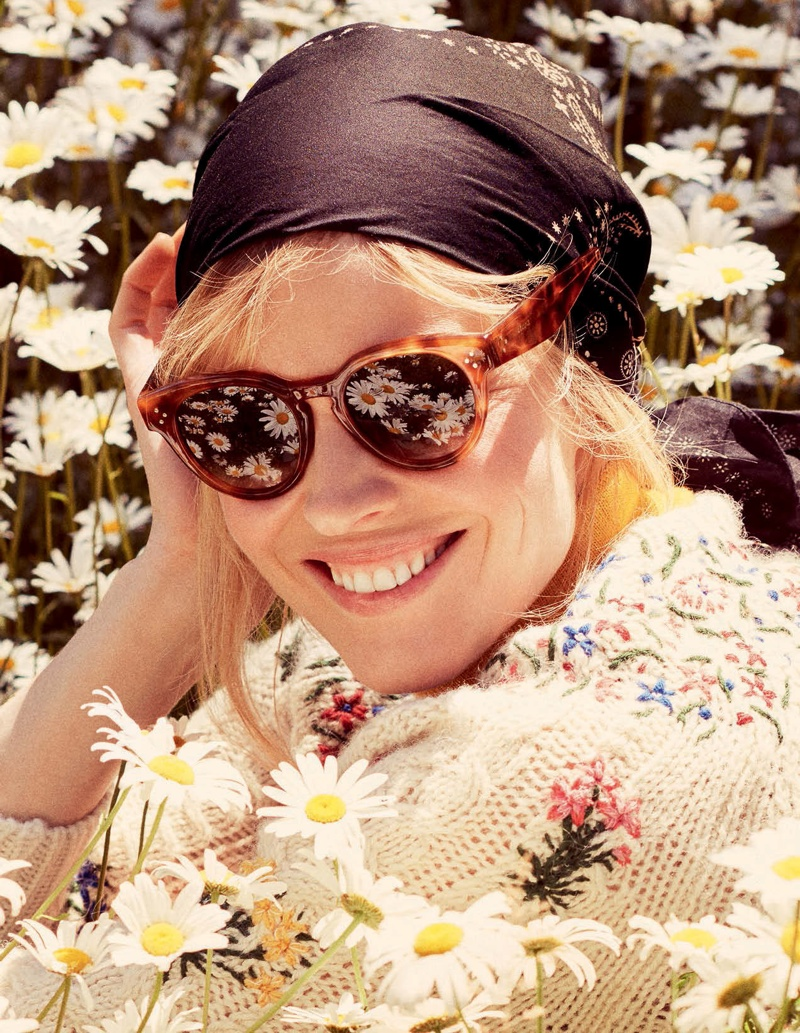 Eva poses outdoors with beautiful blooms for the editorial