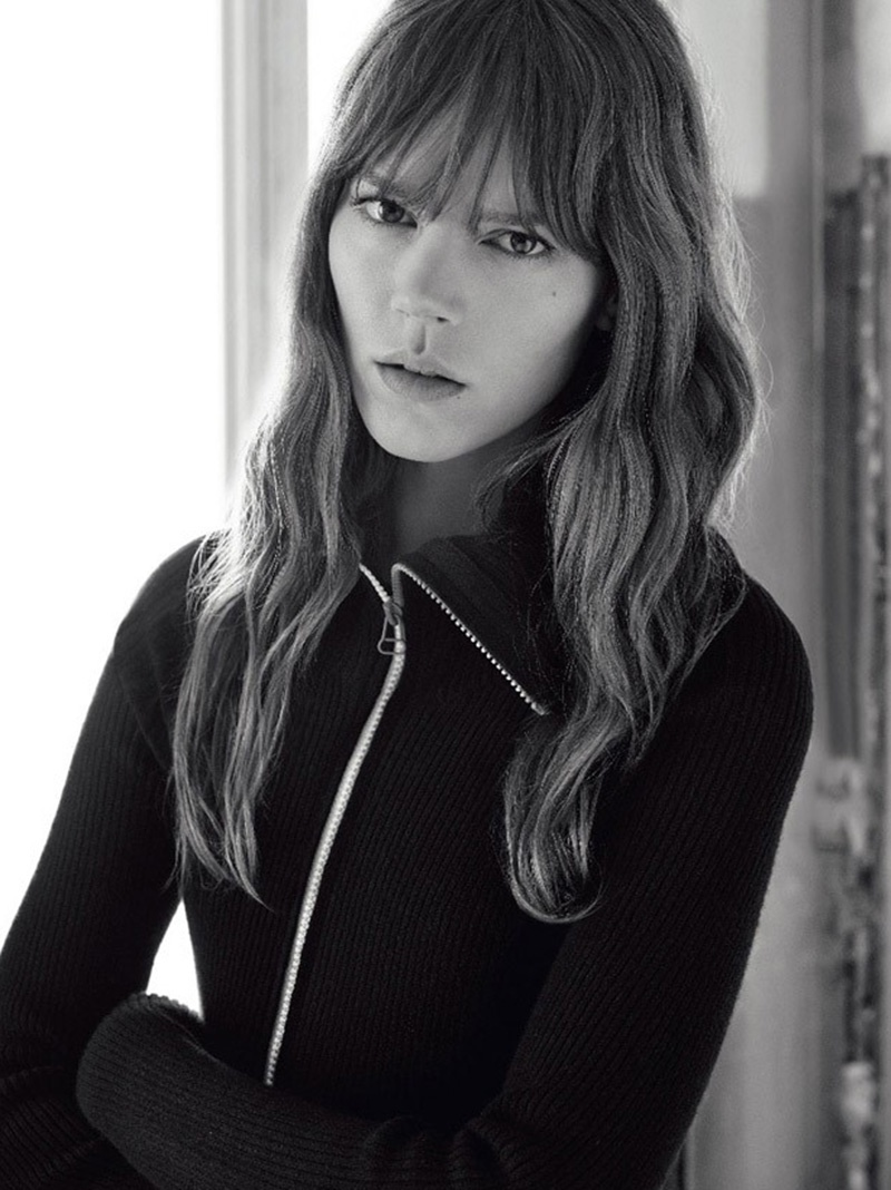 Freja Beha wears her signature hairstyle with wavy tresses and blunt bangs