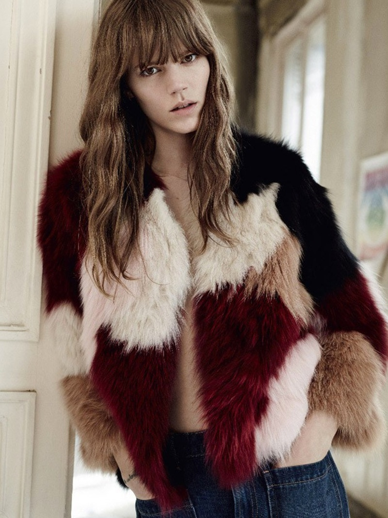The model poses in a fur multi-colored coat