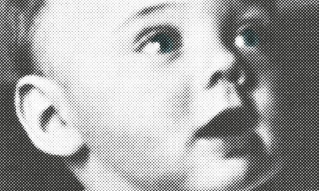 Giorgio Armani unveils the cover of his upcoming biography, simply called, 'Giorgio Armani'. The black and white image features Armani as a baby.