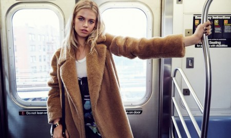 Hailey models a fur coat look on the New York subway
