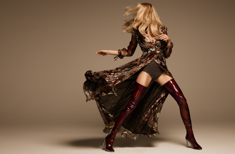 The model is all legs in knee-high boots