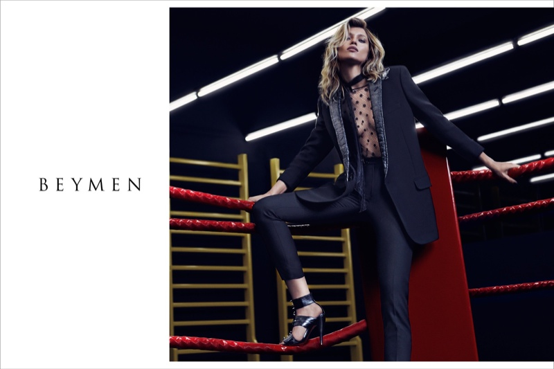 The model wears tuxedo jacket, sheer top and slim-fit pants from Saint Laurent