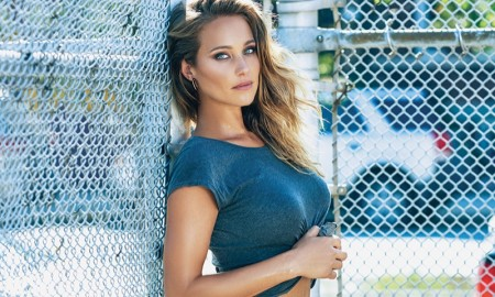 The Sports Illustrated model poses in denim looks and cropped tees