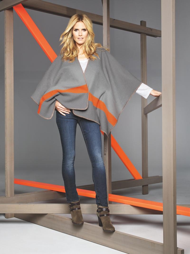 Heidi wears a fleece poncho from Macy's INC