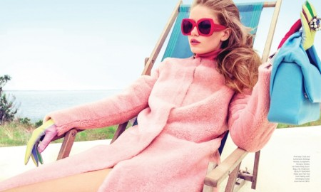Hollie-May wears Bottega Veneta coat, turtleneck and sunglasses