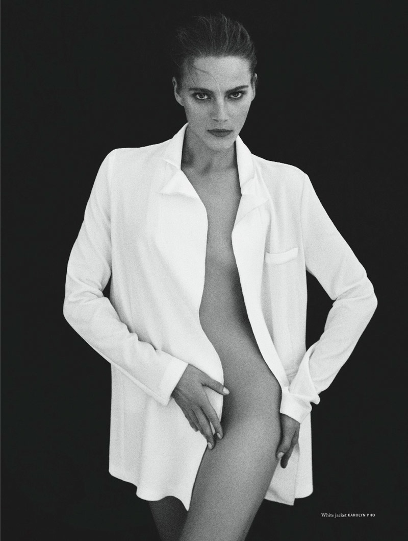 DARE TO BE BARE: Ieva goes naked save for a white jacket