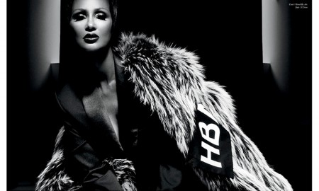 Iman models Hood by air Coat and J. Crew pantsuit