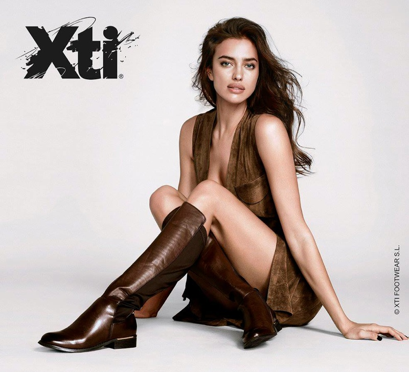 Irina models a knee-high boot in brown