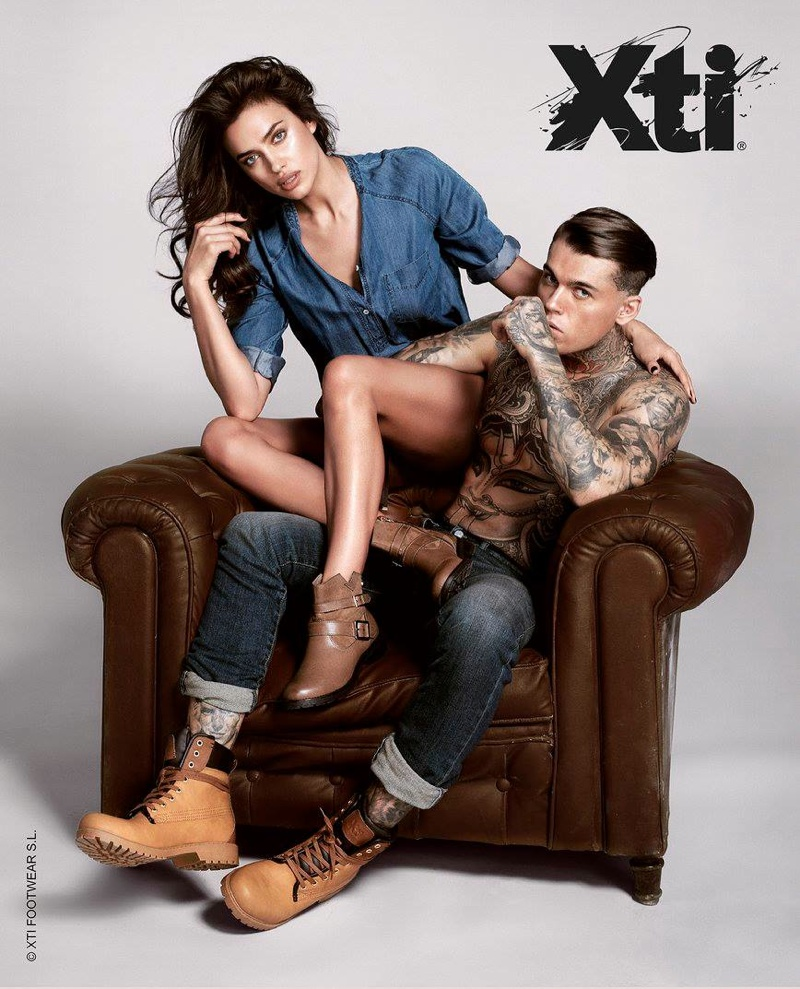 Irina poses alongside male model Stephen James in the advertisements