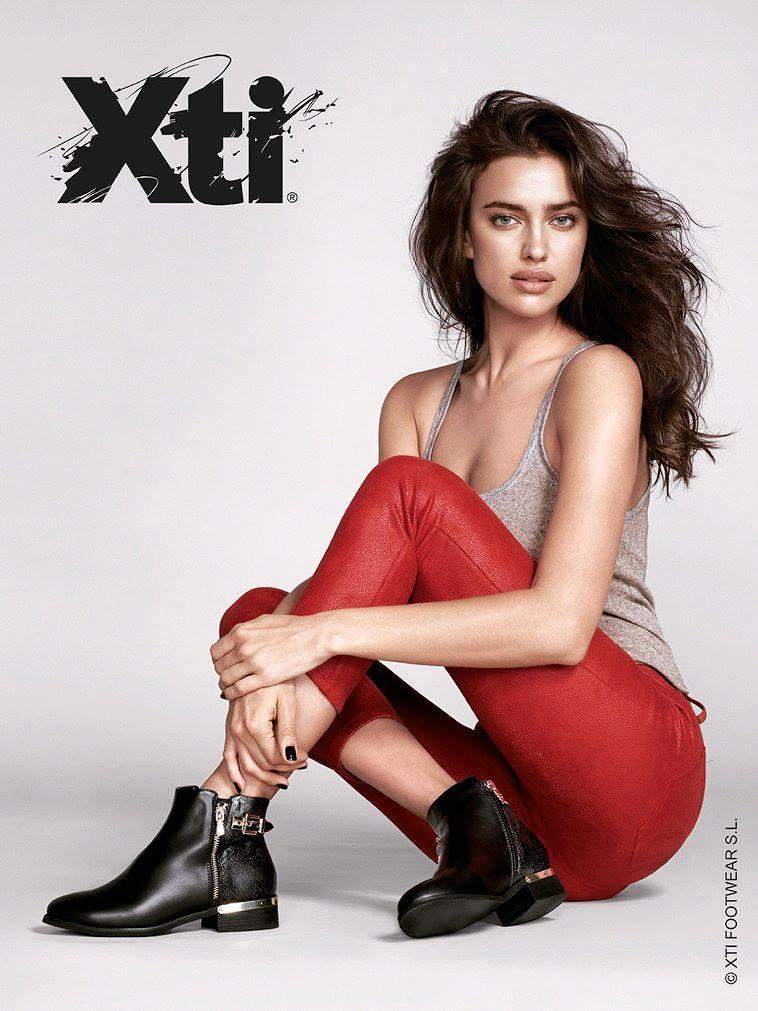 RED HOT: Irina wears slim-fit pants in red
