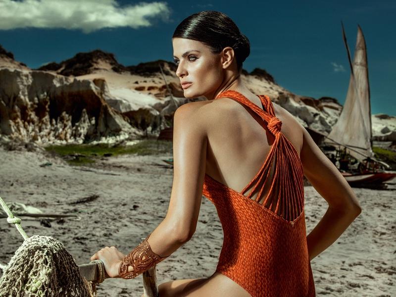 Isabeli models orange one-piece swimsuit