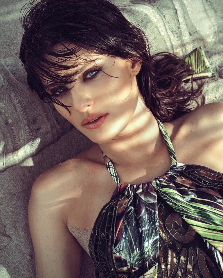 The Brazilian model soaks up the sun in summer style