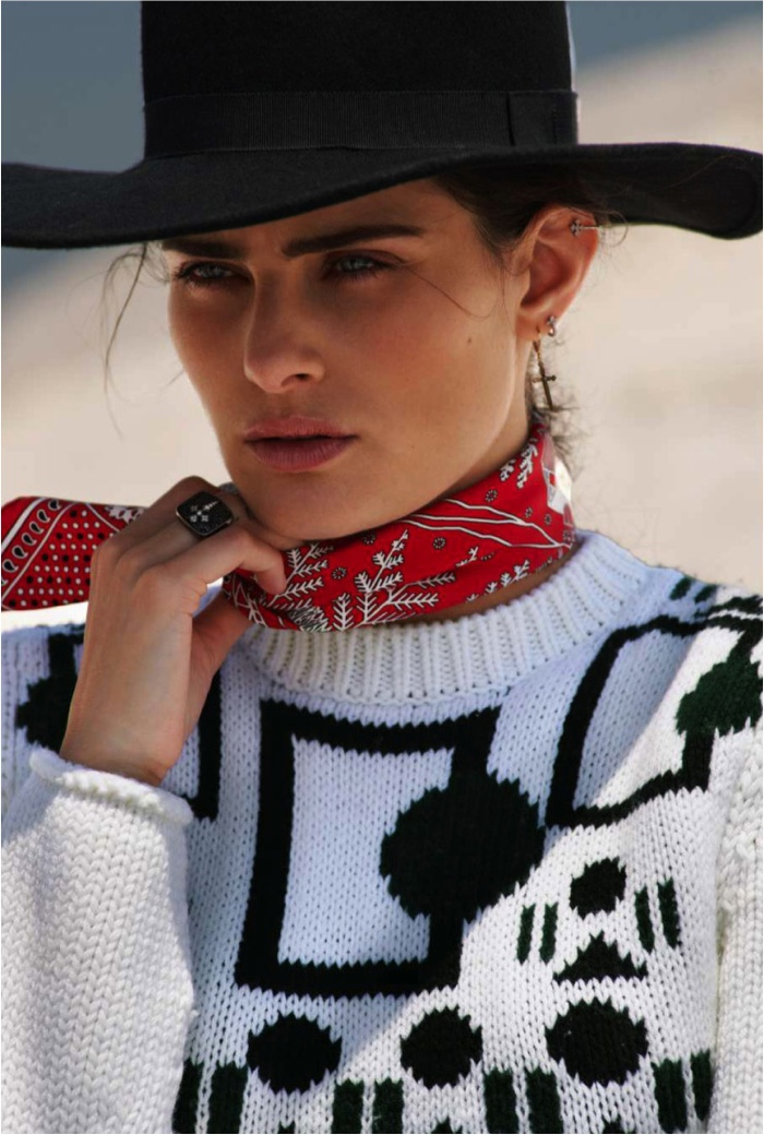 Isabeli accessorizes with colorful scarf and wide-brimmed hat