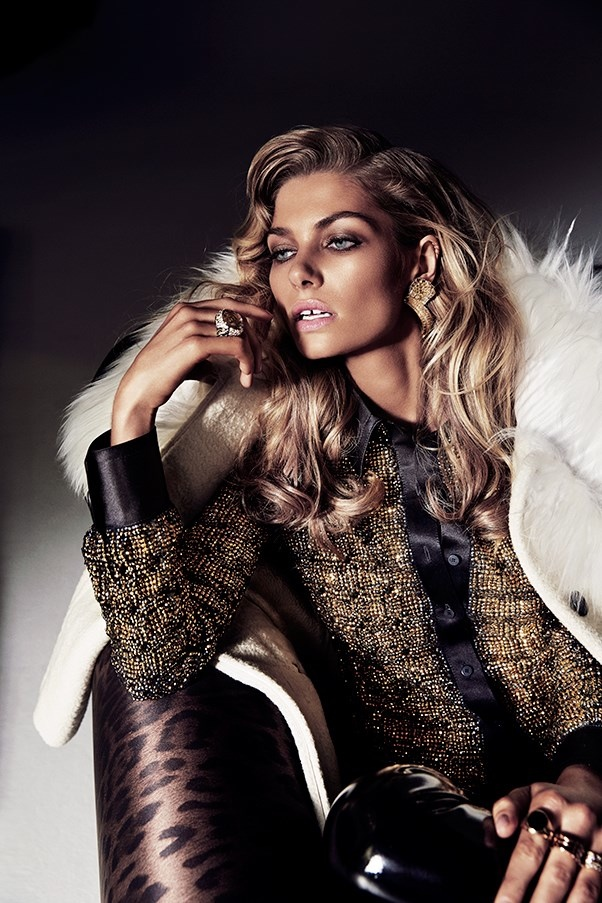 The gap-tooth model sports a fur coat and glittering top