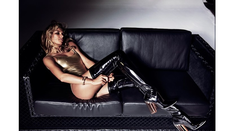 Jessica flaunts her figure in a gold bodysuit and thigh-high boots