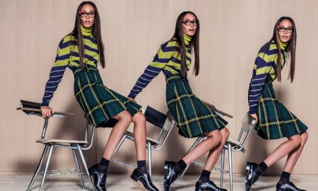 The model looks geek chic in glasses and whimsical prints
