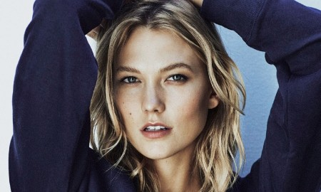 Karlie models a sweater with New York placed on the front