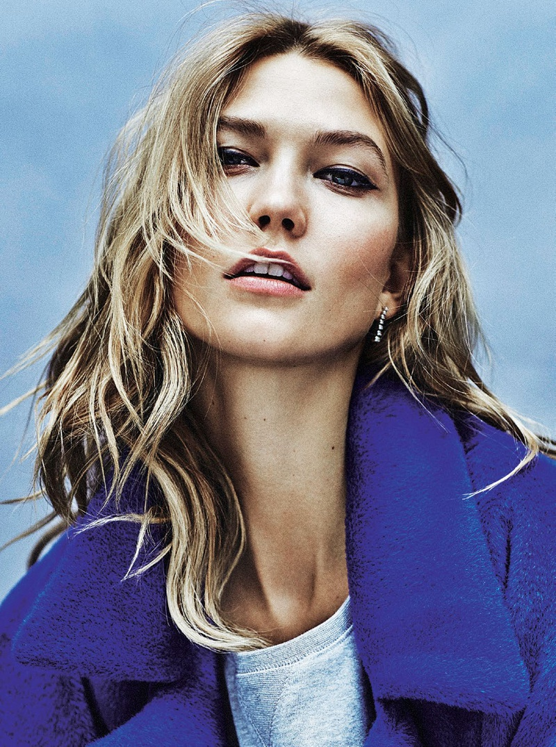 Karlie poses in a blue coat