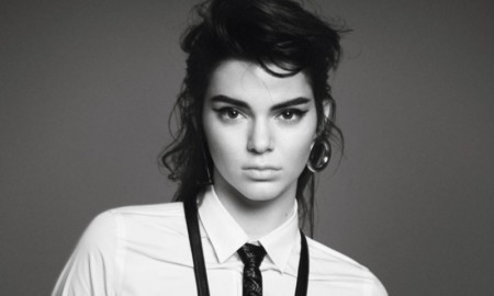 Kendall poses in skinny tie and suspenders
