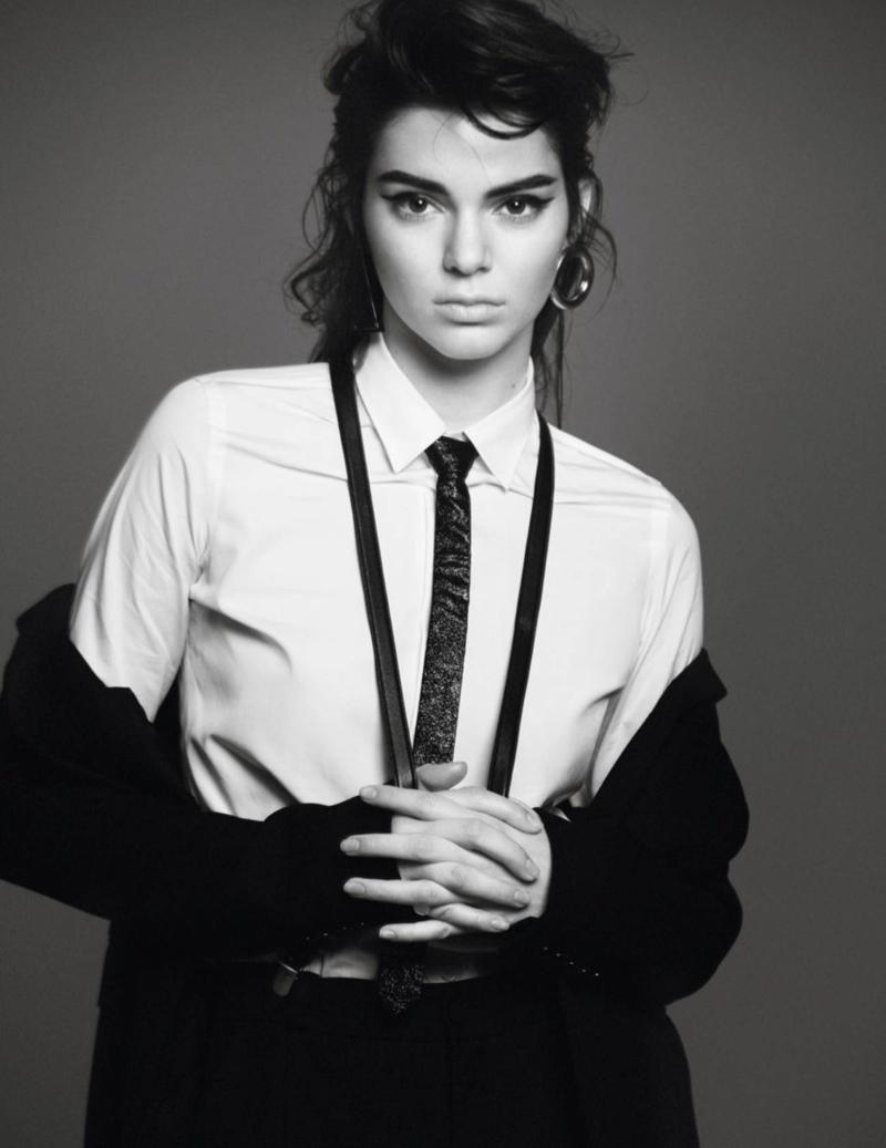 Kendall poses in skinny tie and suspenders