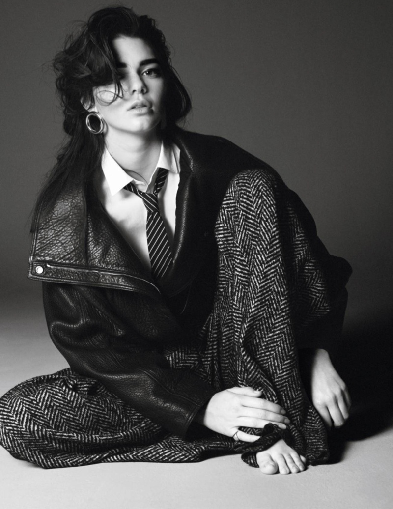 Kendall poses with tie and bomber jacket