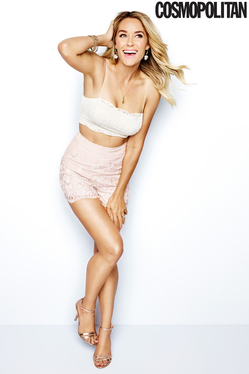 Lauren Conrad rocks a white crop top with pink shorts in Cosmopolitan