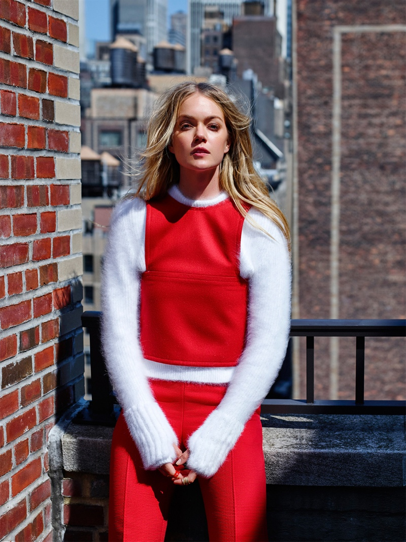 Lindsay sports Fendi top and pants in red with Luis Morais sweater