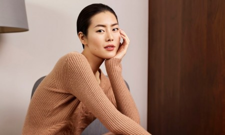 Liu Wen poses in ribbed knit sweater and matching skirt