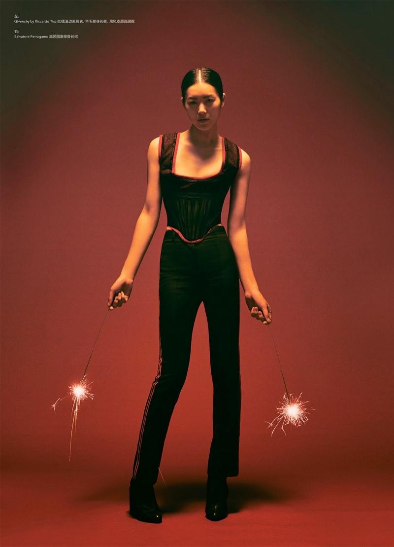 Liu Wen models Givenchy corset top and slim-fit pants