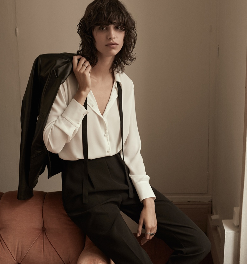 Mica models high-waist trousers, blouse and suit jacket from Mango