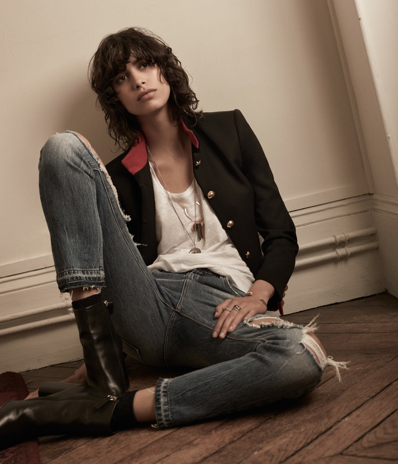Mica poses in band jacket, t-shirt and ripped denim from Mango