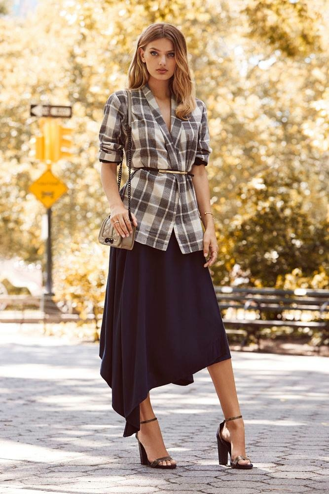 Bregje models plaid jacket and asymmetrical skirt