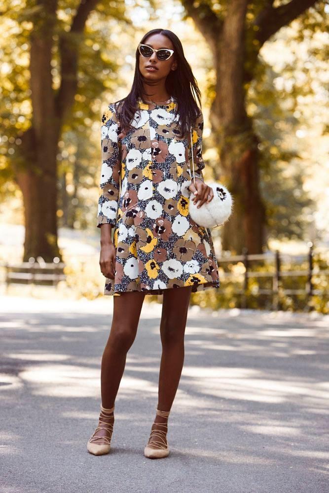 Jasmine poses in multi-print dress