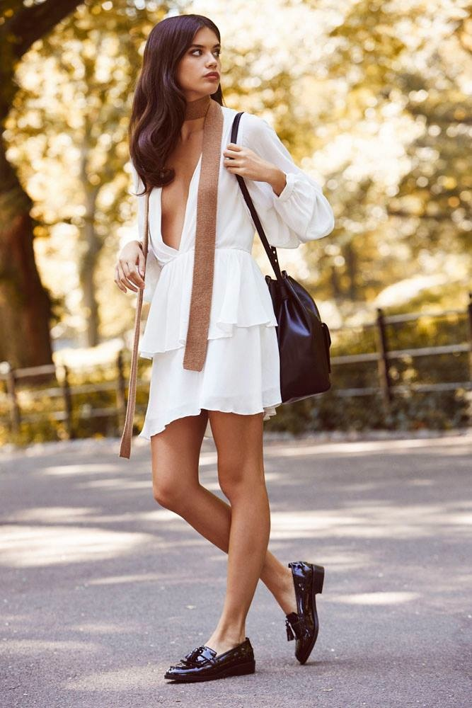 Sara models white gathered dress