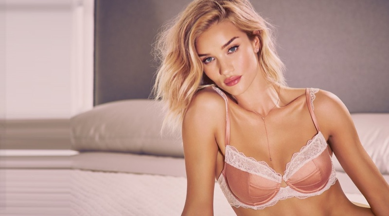 Rosie looks pretty in pink wearing a lace and satin bra