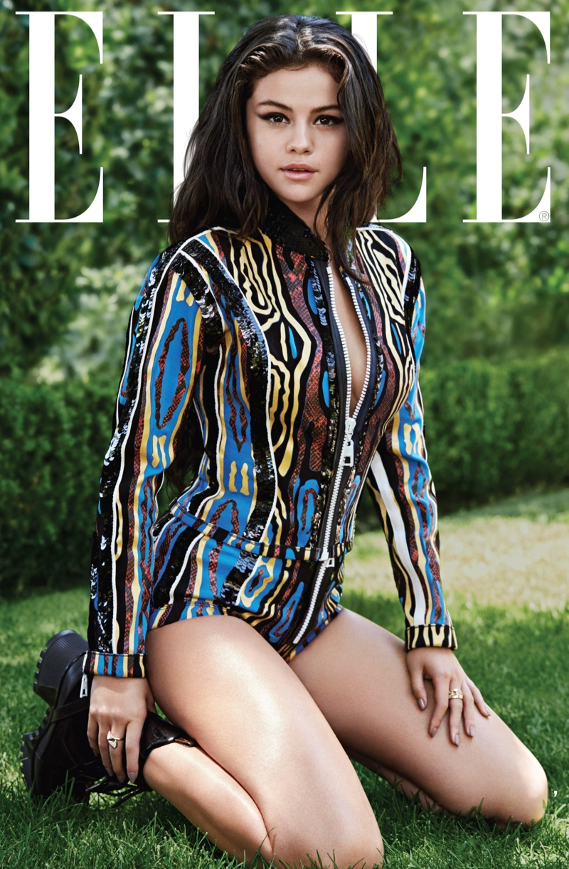 Selena wears Louis Vuitton jacket and shorts in ELLE
