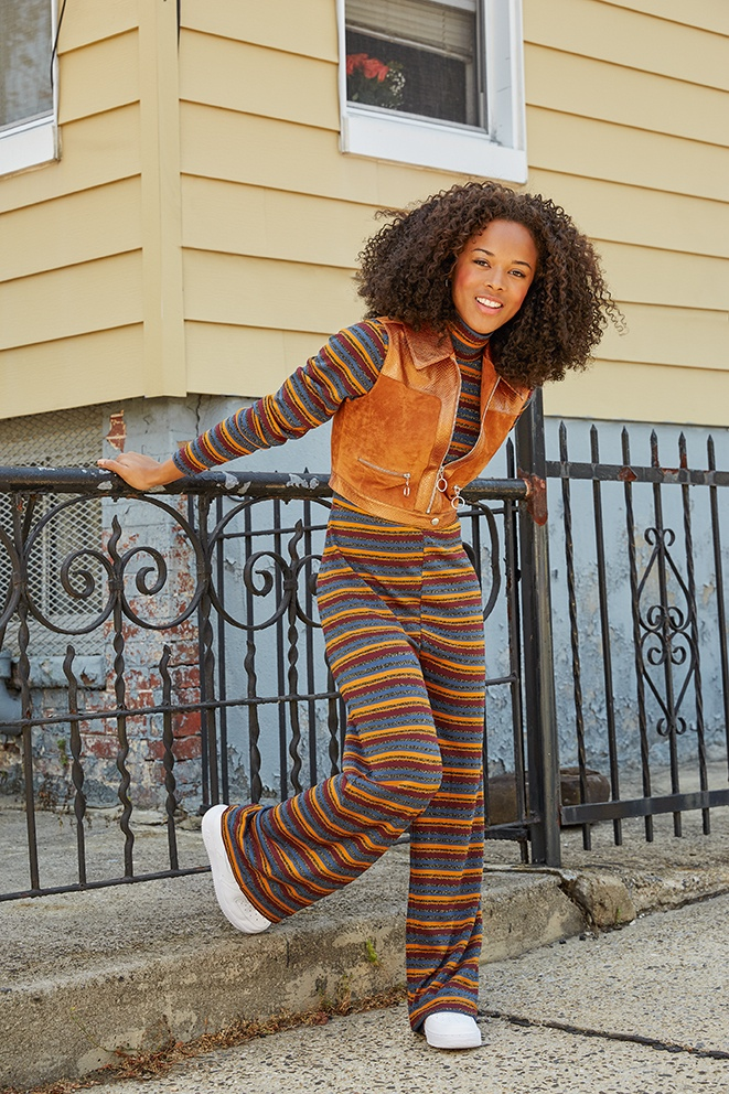 Serayah sports a striped jumpsuits with a vest