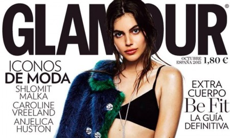 Shlomit Malka stars on Glamour Spain's October 2015 cover. Photographed by Gregory Derkenne, the model wears a fur jacket with black bra top and shorts.