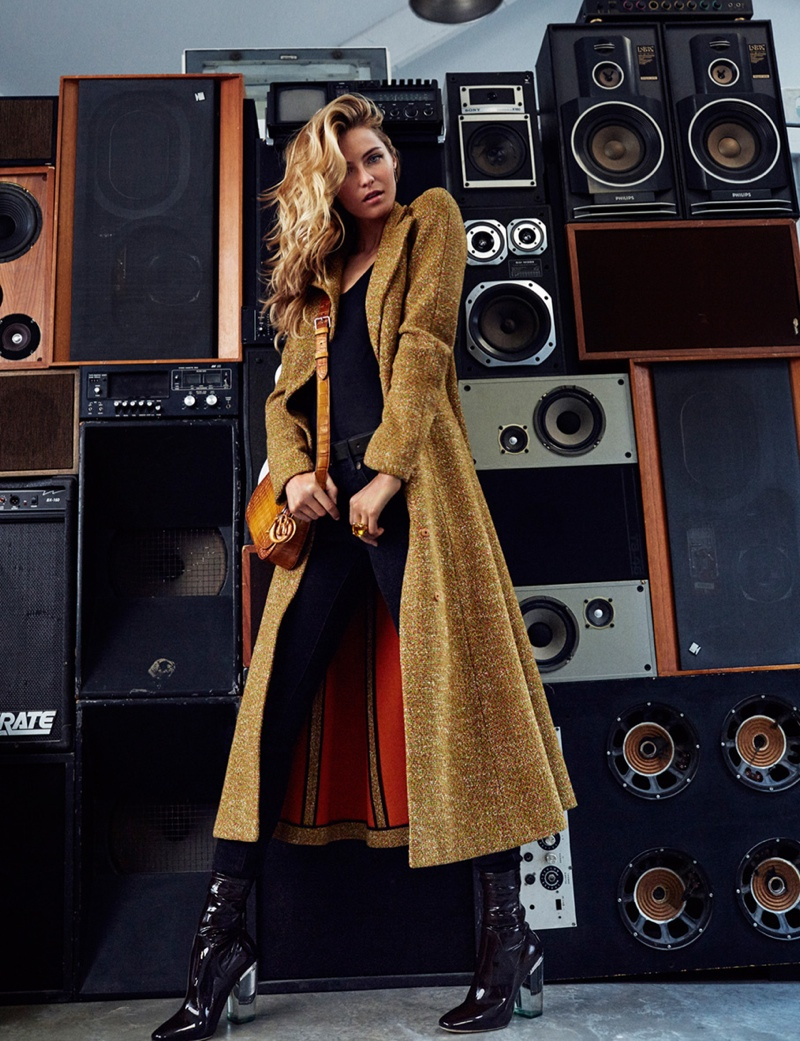 Valentina covers up in a long coat