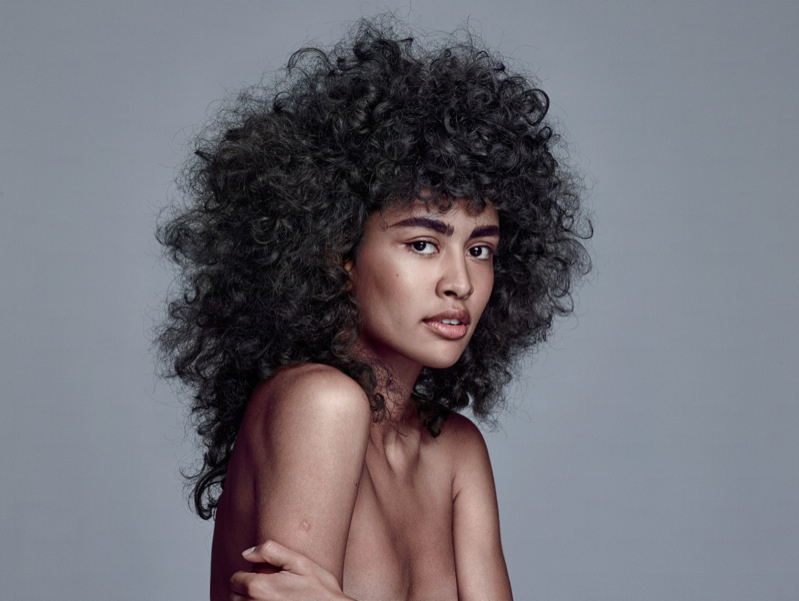 Model wears a curly hairstyle